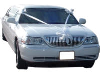 Cars for Stars (Portsmouth) - Wedding Limo. White Lincoln stretched wedding limousine with white ribbons